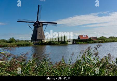 Windmill in Kinderdijk, Netherlands - Stock Photo