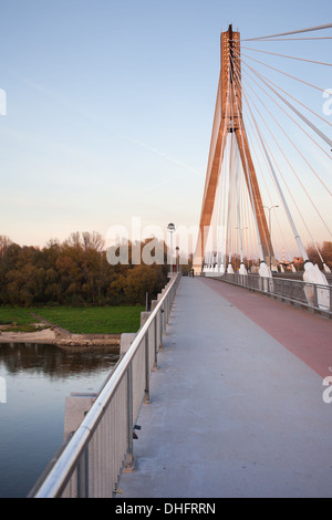 Swietokrzyski cable-stayed bridge over Vistula river in Warsaw, Poland. - Stock Photo