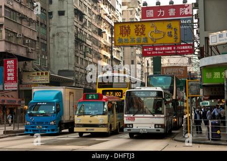 Dense traffic at a crossing with Nathan Road, Kowloon, Hong Kong - Stock Photo