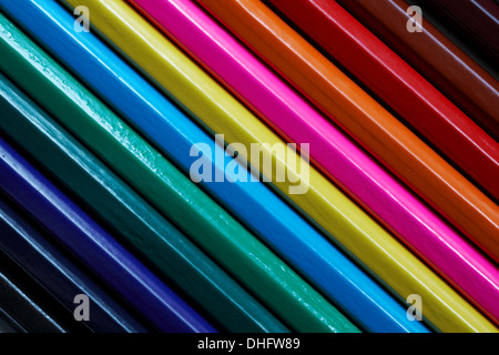 abstract of diagonal lines of coloured pencils - Stock Photo