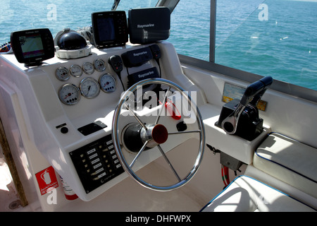 Steering wheel and instrument panel of a motorboat in Bahrain - Stock Photo