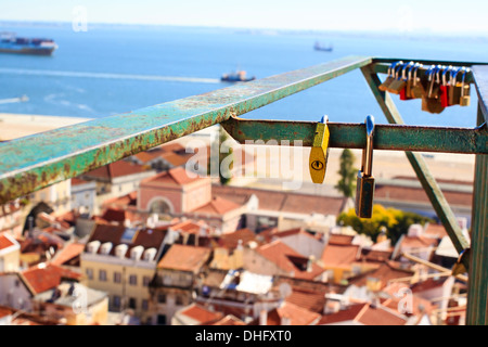 Love locks at one of the the 'Miradouro' viewpoints in the central Lisbon, Portugal - Stock Photo