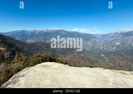 View of Highway 180 Kings Canyon from a rocky outcrop, Hume Lake Road, Sequoia National Forest, California, USA. - Stock Photo