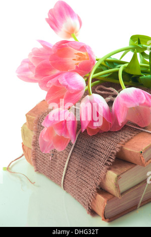 Pink tulips on old books - Stock Photo