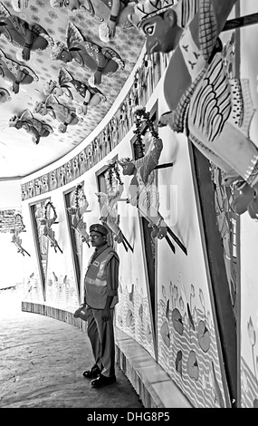 Adult man, Civil Volunteer inside a Pandal for Goddess Durga Worship, Calcutta, Bengal, India in Black and white - Stock Photo
