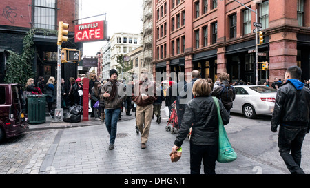 shoppers tourists & residents crowd Prince street & cluster outside iconic Italian Fanelli cafe restaurant in New - Stock Photo