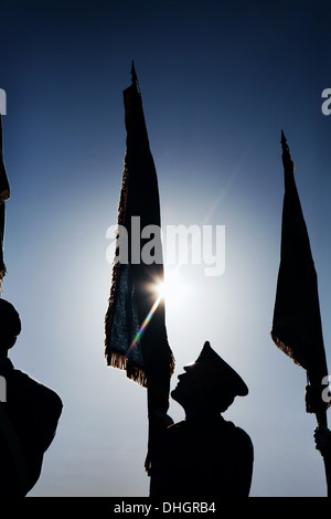 Standard bearers at a Remembrance Sunday sevice. - Stock Photo