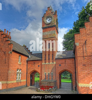 Clocktower at Walsall town Arboretum park pond , West Midlands England , UK - Stock Photo
