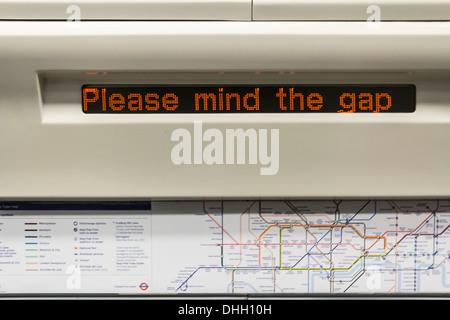'Please Mind the Gap' Notice on a London Transit Train - Stock Photo