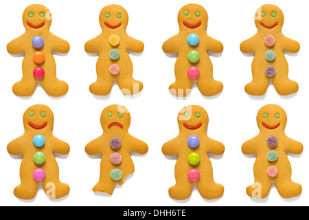 Smiling gingerbread men with one exception, isolated on a white background. - Stock Photo