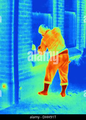 Thermal photograph of a burglar breaking into a house - Stock Photo