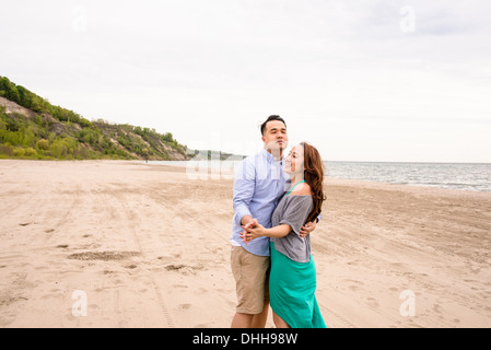 Young couple dancing on beach - Stock Photo