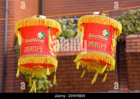 Chinese Lanterns hanging in Chinatown London England - Stock Photo