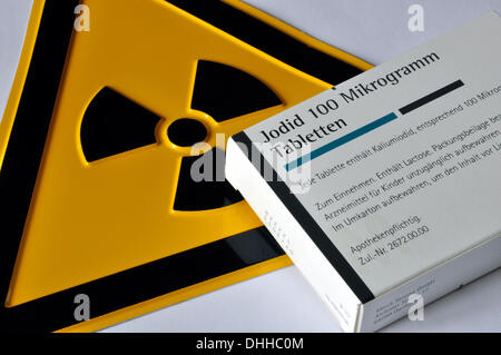 (ILLUSTRATION) A pack of iodine tablets lies on a radioactivity warning sign in Germany, 03 April 2011. Photo: Berliner - Stock Photo