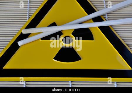 (ILLUSTRATION) Chopsticks lie on a radioactivity warning sign in Germany, 01 April 2011. Photo: Berliner Verlag/Steinach - Stock Photo