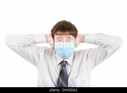 Shocked Young Man in Flu Mask - Stock Photo