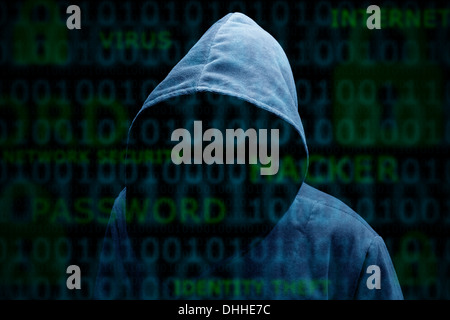 Hooded silhouette of a hacker - Stock Photo
