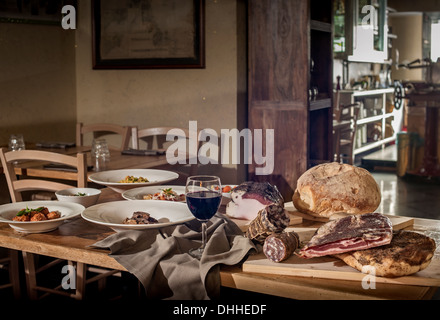 Rustic display of traditional Italian food in restaurant - Stock Photo