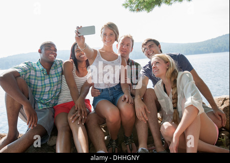Group of friends photographing themselves - Stock Photo