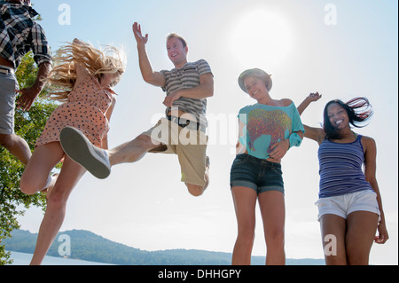 Group of friends wearing summer clothes, low angle - Stock Photo
