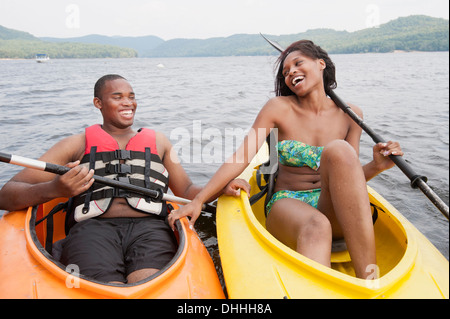 Young couple in canoes - Stock Photo
