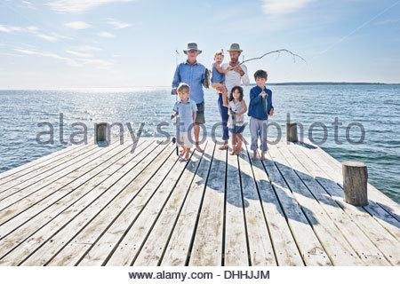 Three generation family on fishing trip, Utvalnas, Sweden - Stock Photo