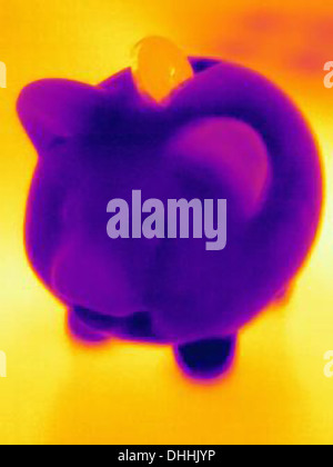 Thermal photograph of piggy bank with coin - Stock Photo