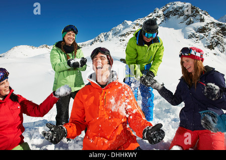 Friends having snowball fight, Kuhtai, Austria - Stock Photo