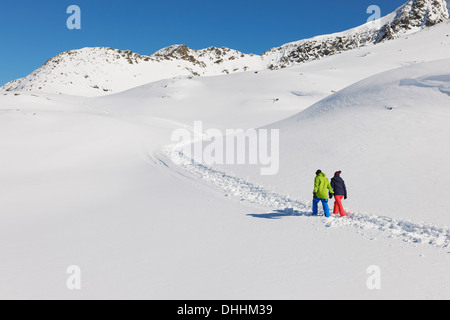 Couple walking in snow, Kuhtai, Austria - Stock Photo