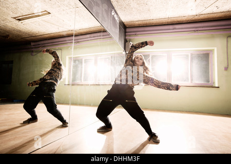 Breakdancer dancing in front of a mirror wall, Terfens, Tyrol, Austria - Stock Photo