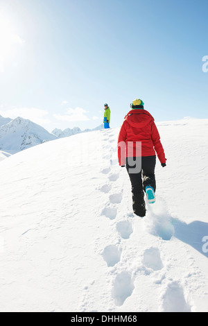 Two people walking in snow, Kuhtai, Austria - Stock Photo
