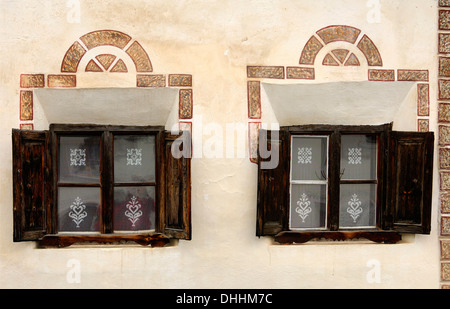 Windows of an Engadin house decorated with Sgraffito, Scuol, Canton of Graubünden, Switzerland - Stock Photo