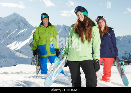 Friends holding snowboards, Kuhtai, Austria - Stock Photo