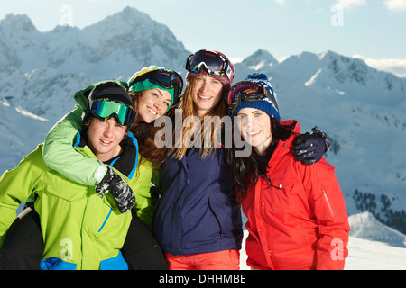 Friends with arms round each other, Kuhtai, Austria - Stock Photo