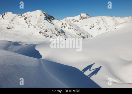 Shadow of couple holding hands in snow, Kuhtai, Austria - Stock Photo