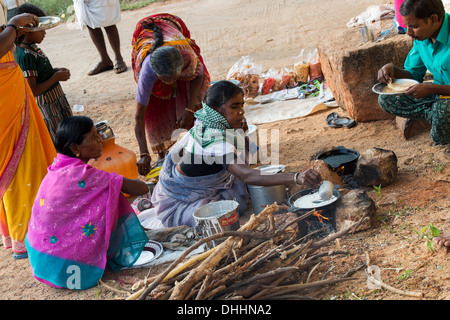 Indian woman cooking dosa for people on the street in a rural indian village. Andhra Pradesh, India - Stock Photo