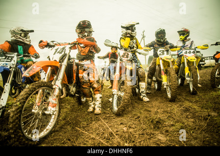 Group of boys on motorcycles at motocross - Stock Photo