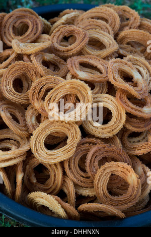 Fried Indian Savory snack food Murukku. Andhra Pradesh, India - Stock Photo
