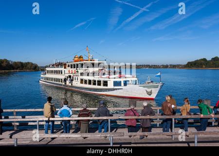 An excursion boat docking, Island Herrenchiemsee or Herreninsel, Chiemsee, Upper Bavaria, Bavaria, Germany - Stock Photo