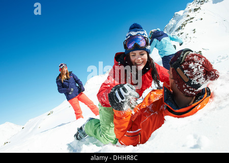 Friends play fighting in snow, Kuhtai, Austria - Stock Photo