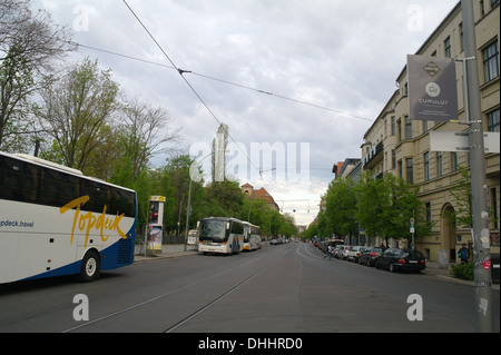 Grey sky early morning view many cars three tourist coaches parked Oranienburger Strasse at Monbijouplatz, looking - Stock Photo
