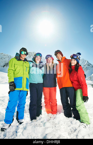 Friends wearing skiwear with arms around each other, Kuhtai, Austria - Stock Photo