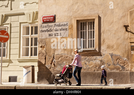 Mother and child walking along the old walls of Prague below Castle Hill, Prague, Czech Republic - Stock Photo