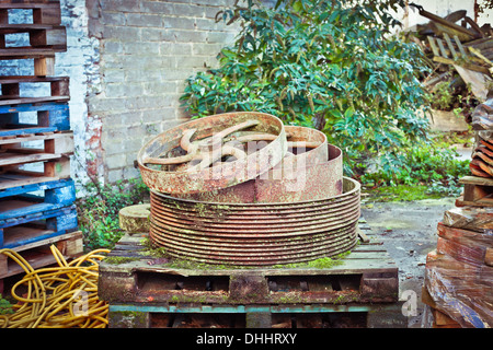 Waste metal and wood in a junk yard - Stock Photo