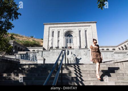 Young woman next to the Matenadaran Manuscript Museum. Yerevan, Armenia - Stock Photo