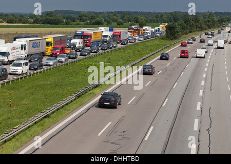 Traffic at a standstill on a German Autobahn, traffic jam, oncoming traffic is flowing, Bavaria, Germany - Stock Photo
