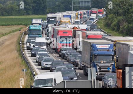Traffic at a standstill on a German Autobahn, traffic jam, bavaria, Germany - Stock Photo