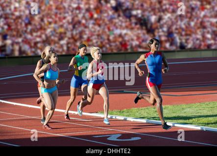 Runners racing on track - Stock Photo