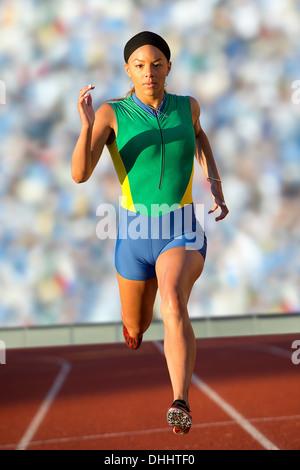 Runner racing on track - Stock Photo