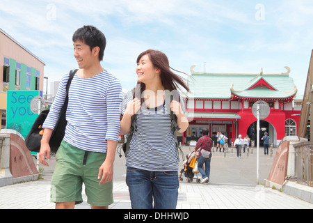 Young couple walking through town - Stock Photo